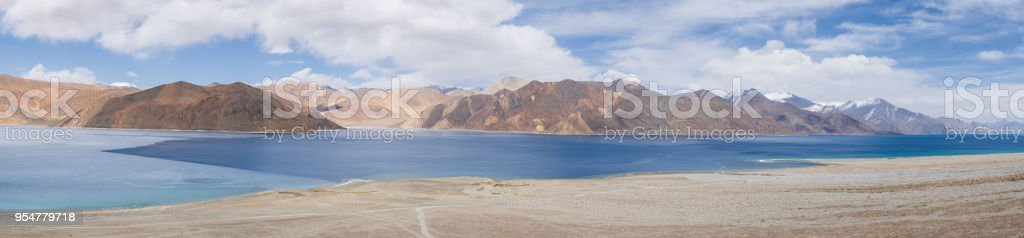 Panorama Pangong Lake in early Spring in Leh Ladakh, North India. Pangong Tso is a beautiful endorheic lake situated in the Himalayas extending from India to China stock photo