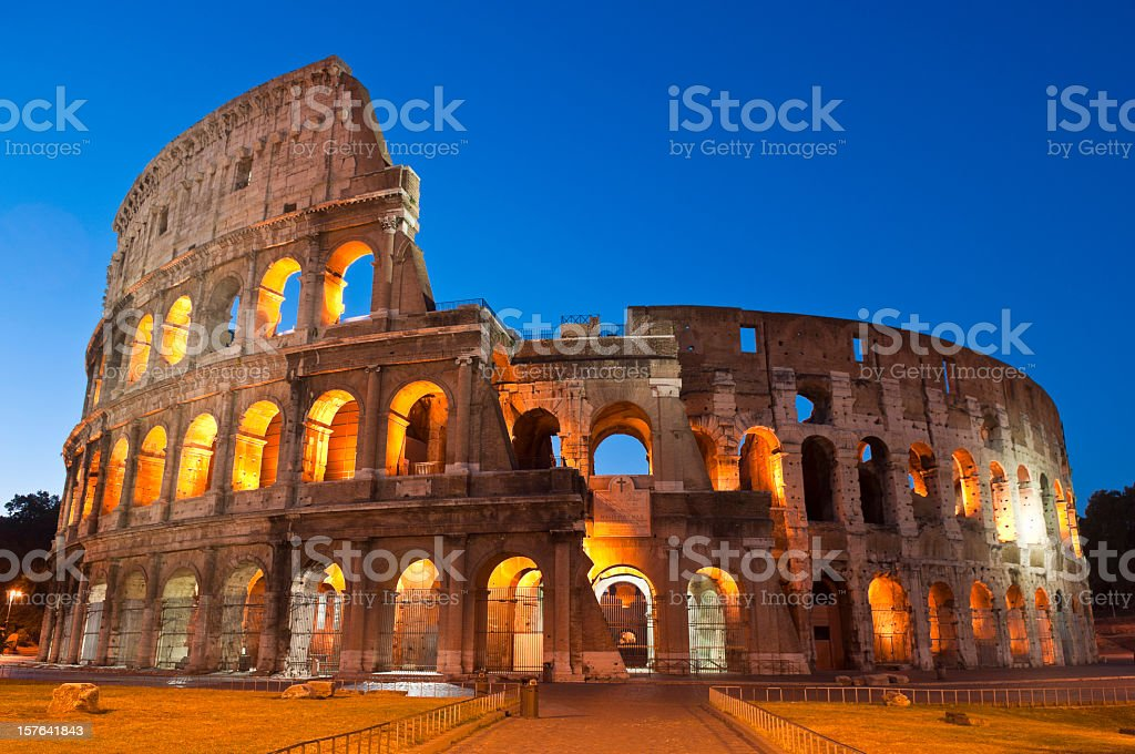 Panorama picture of the Coliseum at night in Rome stock photo