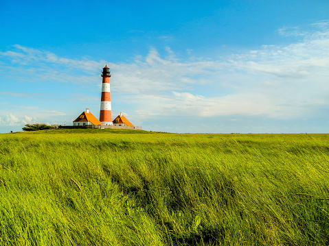 Panorama salt marshes with lighthouse Westerhever