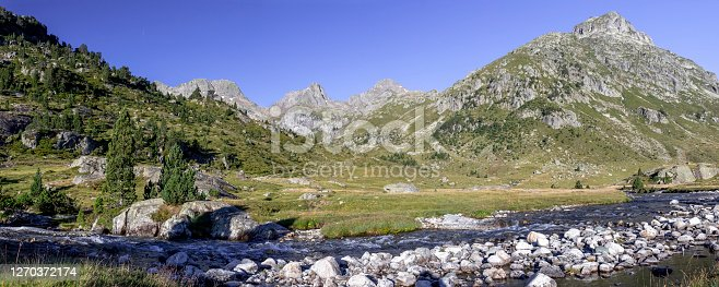 istock Panorama scenery with mountain river surrounded by French Pyrenees High mountains, National park, France 1270372174
