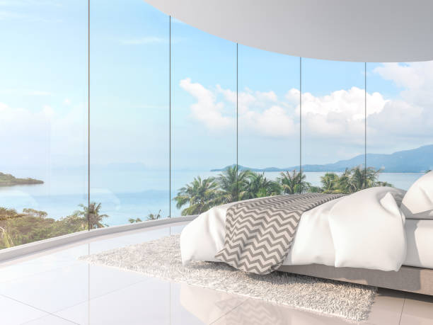 Panorama sea view bedroom 3d render Panorama view bedroom 3d render,There are curve room with white floor,Furnished with white bed,There are large framless bay window overlooking to sea view. penthouse stock pictures, royalty-free photos & images