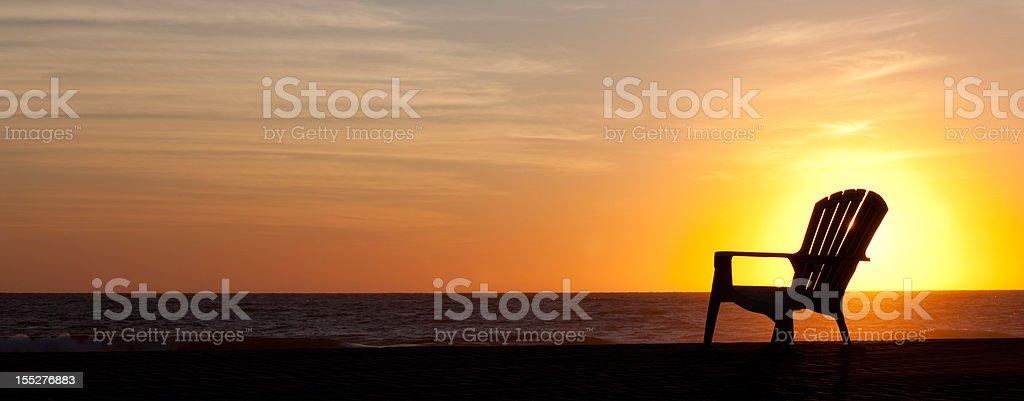 Panorama Silhouette of Muskoka Chair on the Beach stock photo