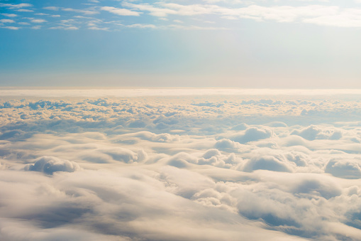 Panorama sky from altitude in the cumulus and layered stratus clouds sunset sunrise.