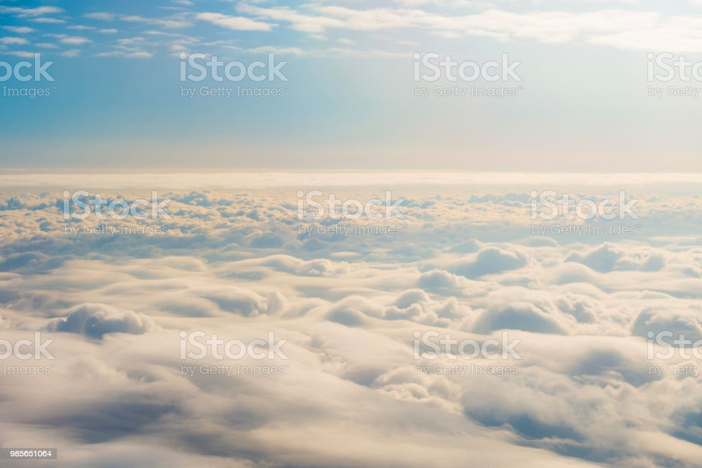 Panorama sky from altitude in the cumulus and layered stratus clouds sunset sunrise. stock photo