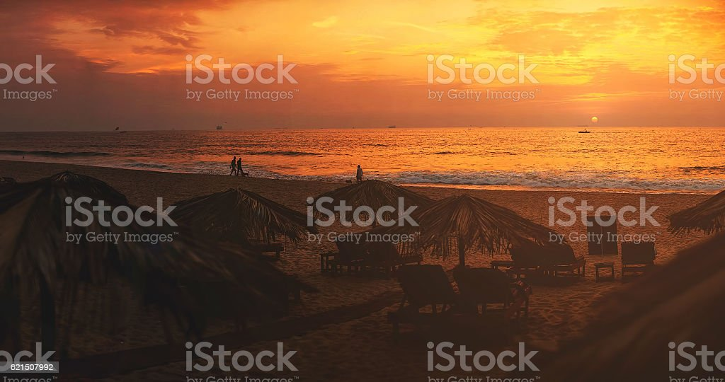 Panorama, Sunset on the beach, lounge chairs, India, Goa photo libre de droits