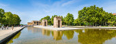 Madrid, Spain - September 15th, 2013: Tourist are walking in Parque del Oeste where Temple of Debod is located. Temple's reflection visible in the surrounding pool. This photograph was taken midday.