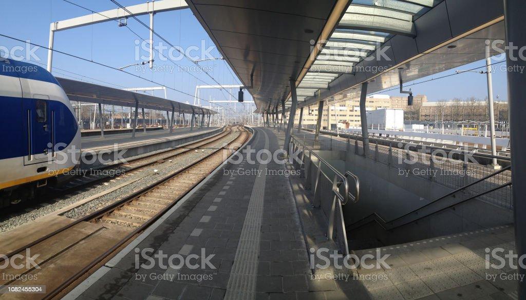 Panorama Utrecht Railway station platform in winter sun
