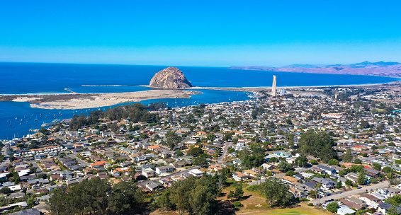 Aerial view, Morro Rock is a volcanic plug in Morro Bay, California, on the Pacific Coast at the entrance to Morro Bay harbor.