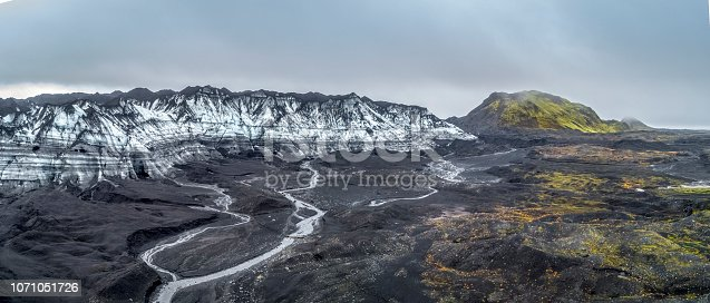 Panoramic view of glacier Kotlujokull against cloudy sky. Dramatic landscape in winter at Iceland. Image is representing idyllic nature and climate change.