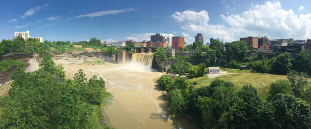 panorama view of high falls and the city of rochester - rochester ny skyline stock photos and pictures