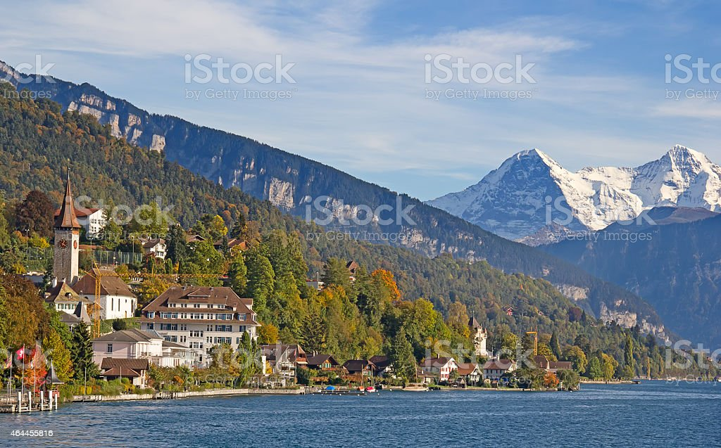 Panorama view of Lake Thun with small towns and mountains stock photo