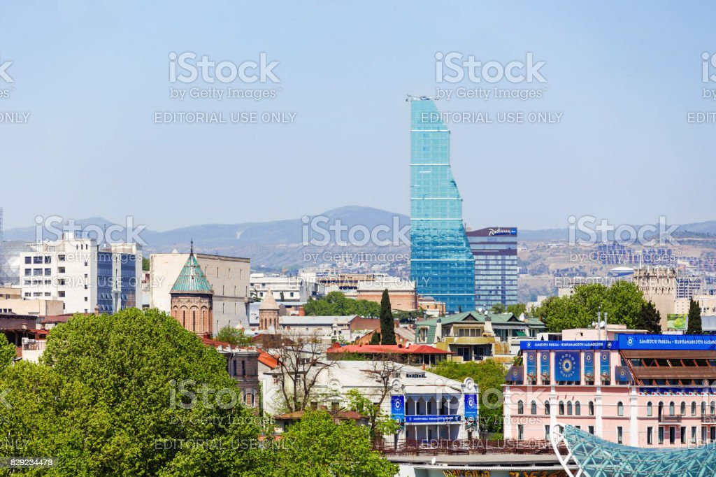Panorama view of Tbilisi. Modern landmark - Biltmore Hotel Tbilisi. stock photo