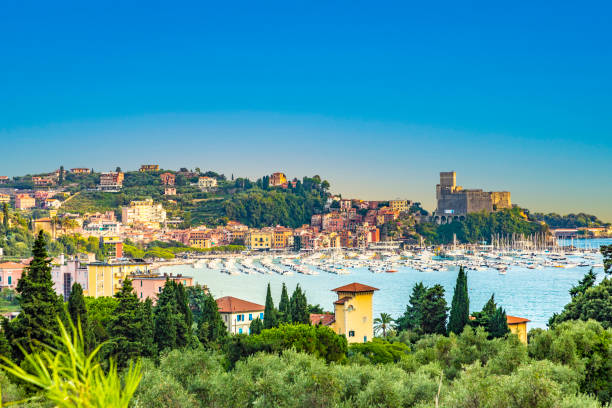 A panorama view of the boats in the Bay of Poets from the path leading to the castle at Lerici, Italy in summertime stock photo