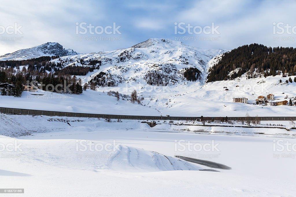 Panorama view of the frozen Davos Lake in Davos dorf stock photo