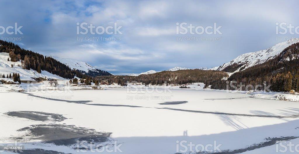 Panorama view of the frozen Davos Lake stock photo