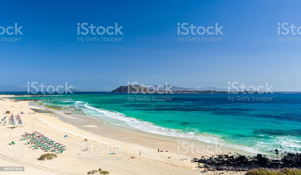 XXL panorama view of the islands of Lobos and Lanzarote seen from Corralejo Beach (Grandes Playas de Corralejo) on Fuerteventura, Canary Islands, Spain, Europe. Beautiful turquoise water & white sand. stock photo