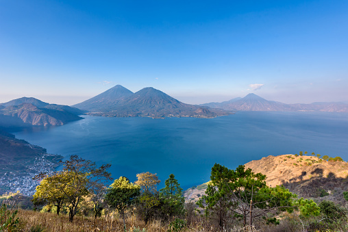 istock Panorama view of the lake Atitlan and volcanos  in the highlands of Guatemala 836756432