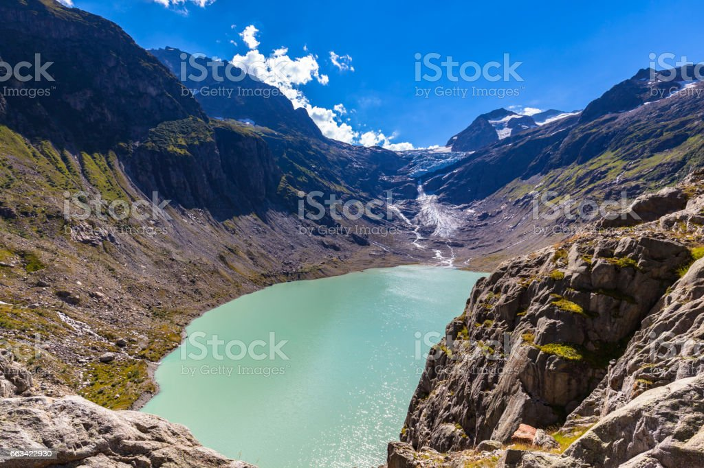 Panorama view of Trift lake and glacier stock photo