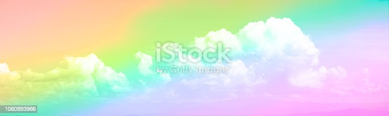 istock Panorama view of white soft Fluffy clouds and rainbow sky 1060893966