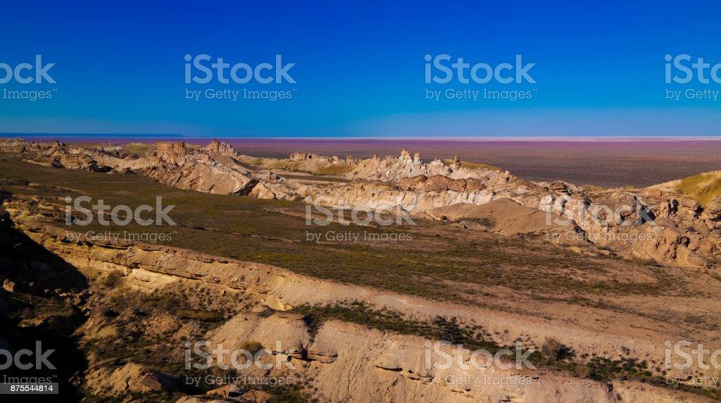 Panorama view to Aral sea from the rim of Plateau Ustyurt at sunset , Karakalpakstan, Uzbekistan stock photo