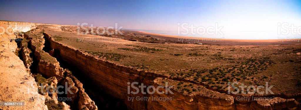 Panorama view to Aral sea from the rim of Plateau Ustyurt near Aktumsuk cape , Karakalpakstan, Uzbekistan stock photo