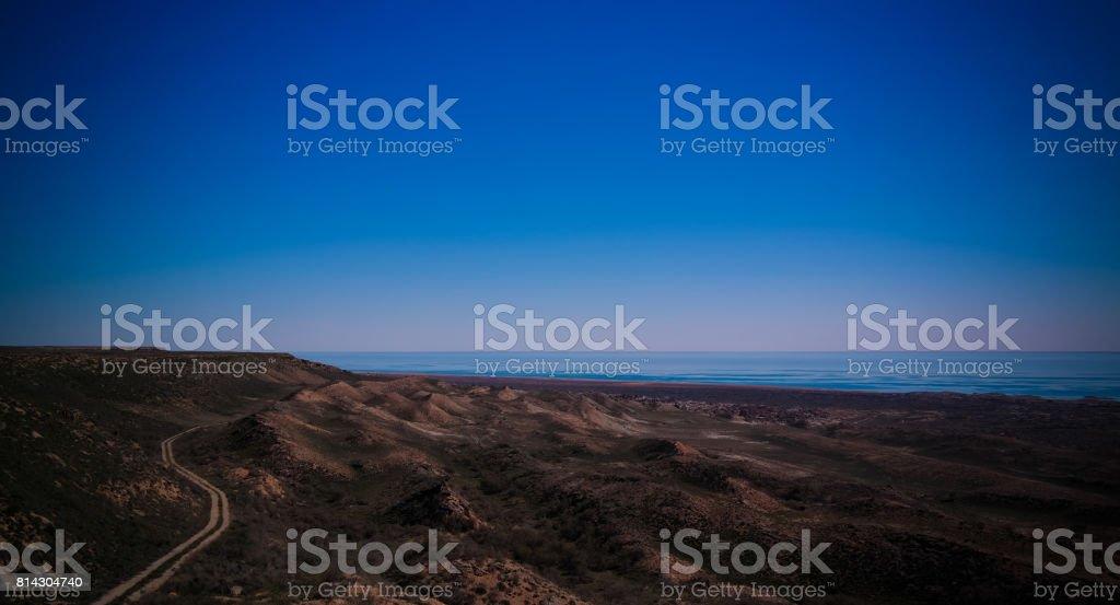 Panorama view to Aral sea from the rim of Plateau Ustyurt near Duana cape , Karakalpakstan, Uzbekistan stock photo