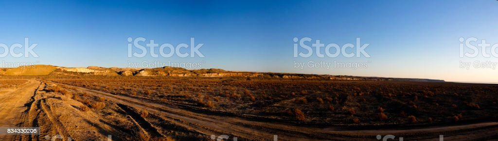 Panorama view to Plateau Ustyurt from the edge of Aral sea near Aktumsuk cape at sunrise, Karakalpakstan, Uzbekistan stock photo