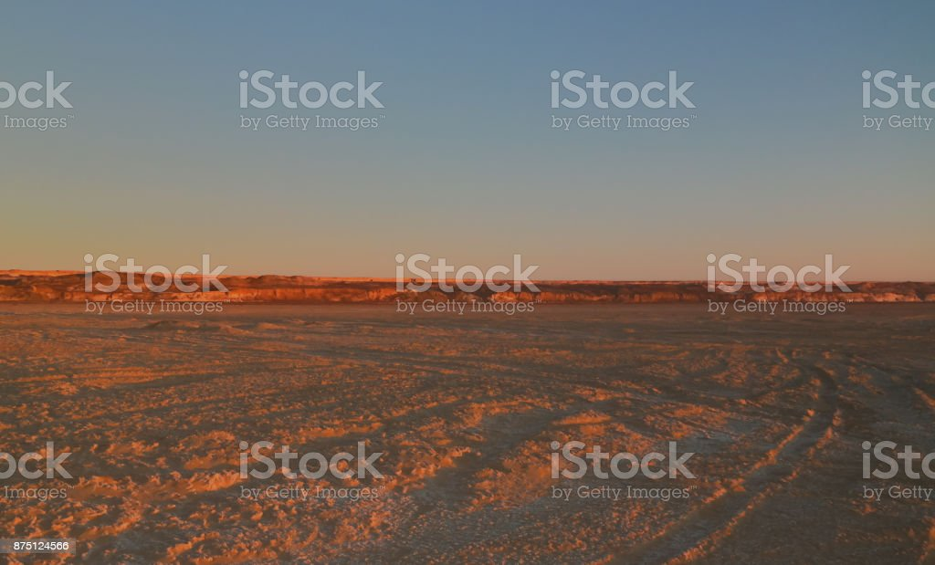 Panorama view to Plateau Ustyurt from the edge of Aral sea near Aktumsuk cape at sunset, Karakalpakstan, Uzbekistan stock photo