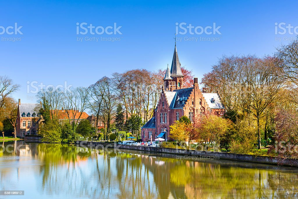 Panorama with Flemish style building reflecting in Minnewater lake, Bruges stock photo