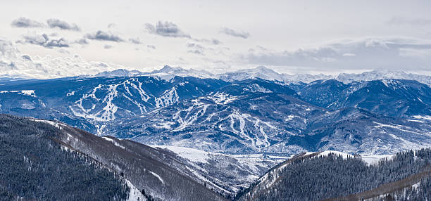 Panoramaic Winter View Beaver Creek Bachelor Gulch Aroowhead Ski Panoramaic Winter View Beaver Creek Bachelor Gulch Aroowhead Skiing Colorado - Landscape scenic with amazing vista showing ski resorts with cut runs. Sawatch Mountain view. beaver creek colorado stock pictures, royalty-free photos & images
