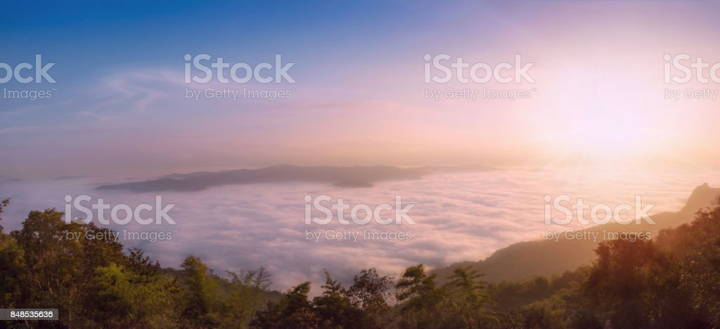 Panorama,Scenic views of the mist on the doi samer dao atmosphere in the morning, doi samer dao is famous in Nan, Thailand. Tourists come overnight, watch the stars at night and in the morning mist. stock photo