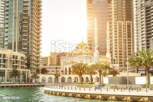 istock Panorami view of Dubai Marina from channel with sunlight and mosque in background 962816516