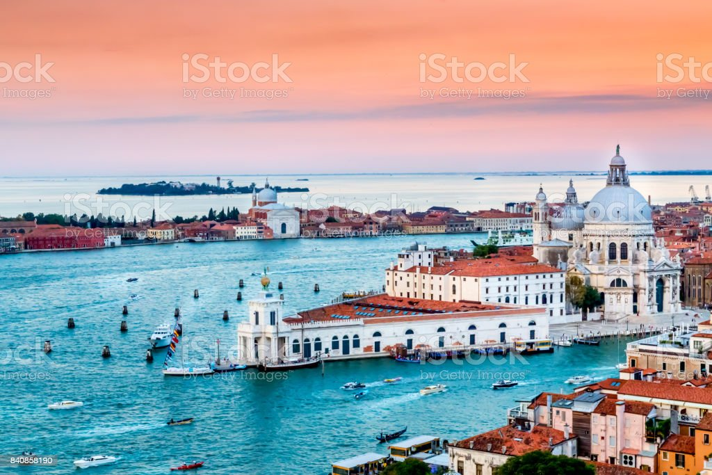 Panoramic aerial cityscape of Venice and Grand Canal with Santa Maria della Salute church at sunset stock photo