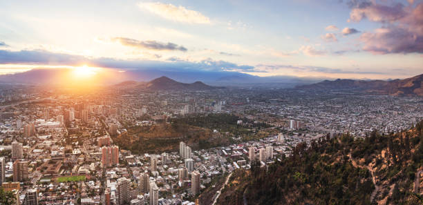 Panoramic aerial view of Santiago from San Cristobal Hill at sunset - Santiago, Chile stock photo