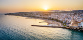 Aerial view of Sitges Village from above the sea at sunset. Catalonia, Spain