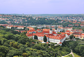 istock Panoramic aerial view of Strahov monastery with charming red roof buildings in the background in Prague, Czech Republic 1013086704