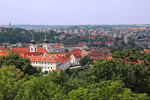 istock Panoramic aerial view of Strahov monastery with charming red roof buildings in the background in Prague, Czech Republic 1013086800