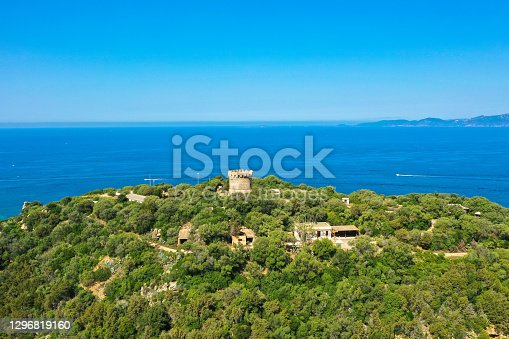 Panoramic aerial view of the Corsican coast with a Genoese watchtower near the capital Ajaccio. Corsica, France.