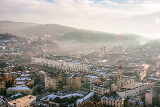 Panoramic Aerial View of Turin and Snowy Italian Alps stock photo