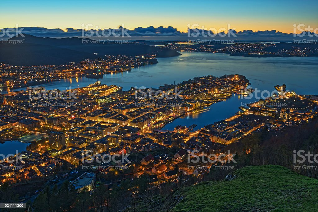 Panoramic aerial view on illuminated Bergen City at dusk, Norway stock photo