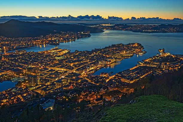 Panoramic aerial view on illuminated Bergen City at dusk, Norway - Photo