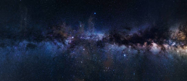 Panoramic astrophotography of visible Milky Way galaxy. Stars, nebula and stardust at night sky stock photo