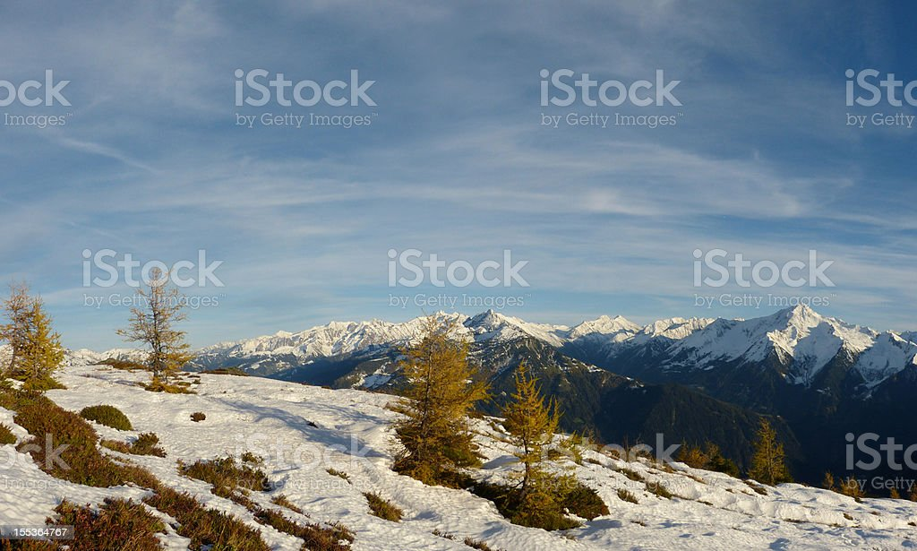 Panoramic autumn and winter in the Alps stock photo