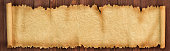 istock Panoramic background of old paper. Unfolded scroll on the table 1154904979