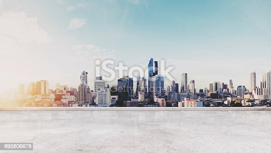 istock Panoramic Bangkok city in sunrise modern buildings, and concrete deck floor 695806678