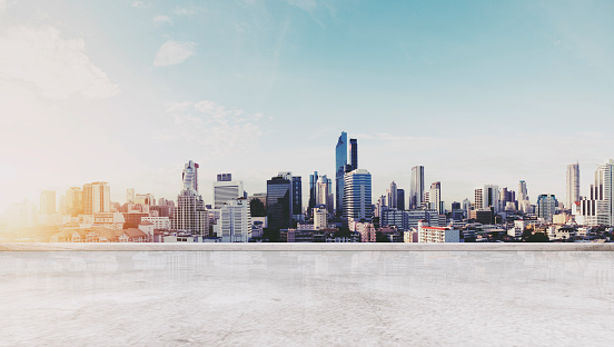 693903950 istock photo Panoramic Bangkok city in sunrise modern buildings, and concrete deck floor 695806678