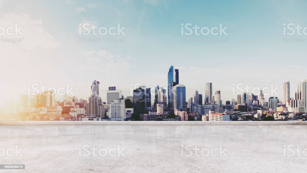 Panoramic Bangkok city in sunrise modern buildings, and concrete deck floor stock photo