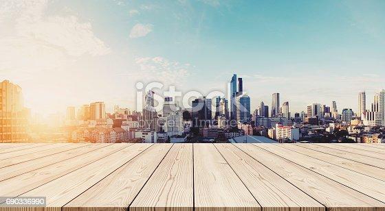 693903950istockphoto Panoramic Bangkok cityscape in sunrise with empty wooden floor 690336990