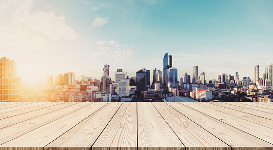 693903950 istock photo Panoramic Bangkok cityscape in sunrise with empty wooden floor 690336990