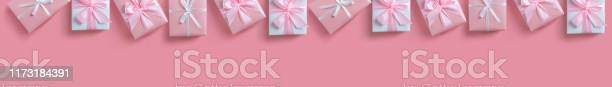 Panoramic banner of gift boxes on pink isolated background picture id1173184391?b=1&k=6&m=1173184391&s=612x612&h=wozez12lr912cde  w2 6yd niij4bsvduwyjitxwua=
